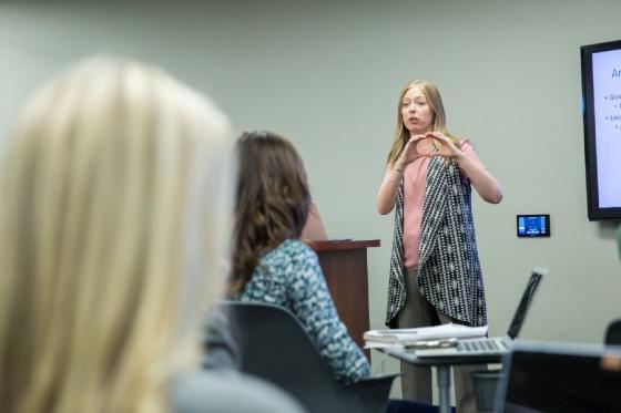 Business professor teaching in class