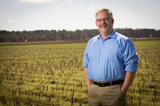 John Butler standing in a field