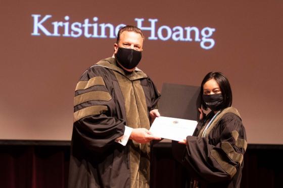 Kristine Hoang receiving her award