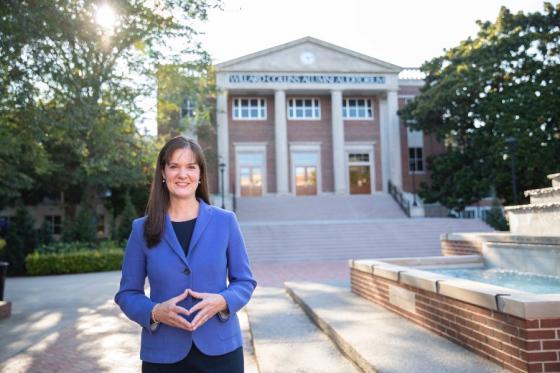 Dr. Candice McQueen in front of Collins Alumni Auditorium.