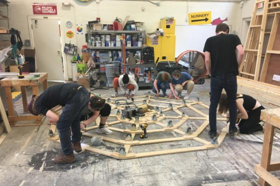 Theatre students constructing the revolve