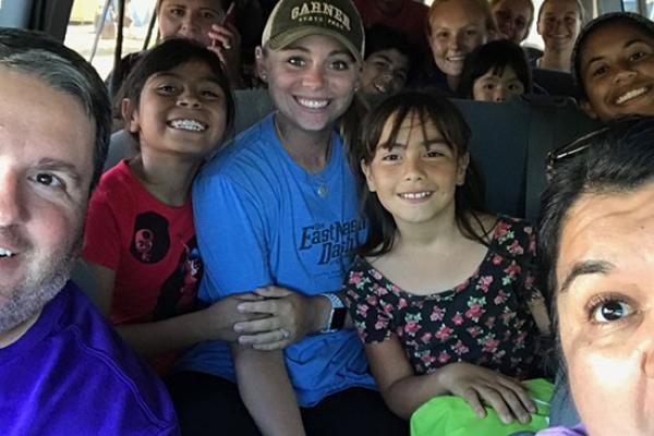 Softball students and coaches on a bus in the Baja